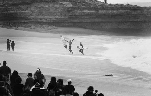 Joel Parkinson and Mick Fanning. Classic moment in a classic arena. Mick immediately became one leg of the chair carrying Joel up the beach, because that's what friends do. PHOTO: Sherman